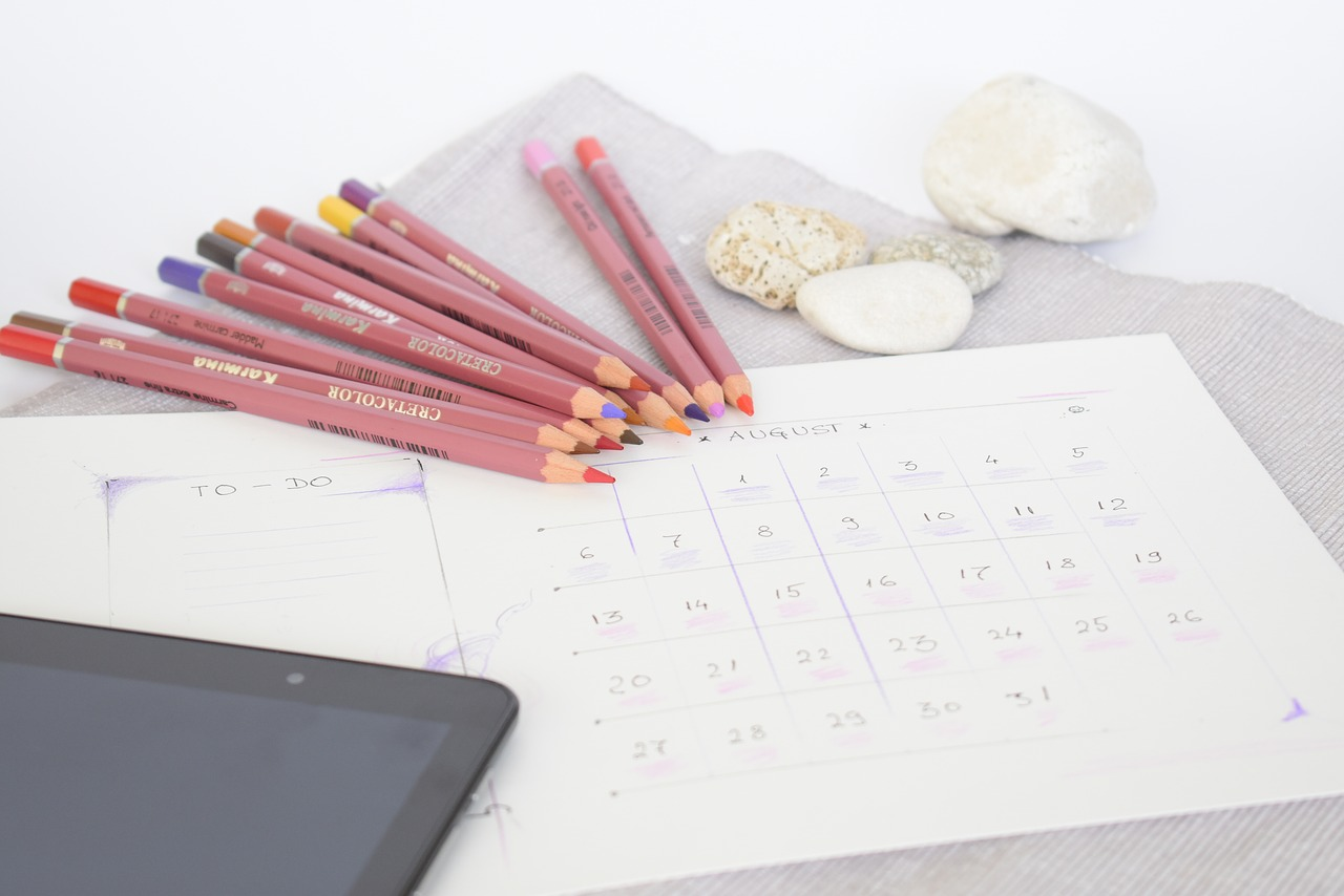 Pencils, tablet, to-do list for August