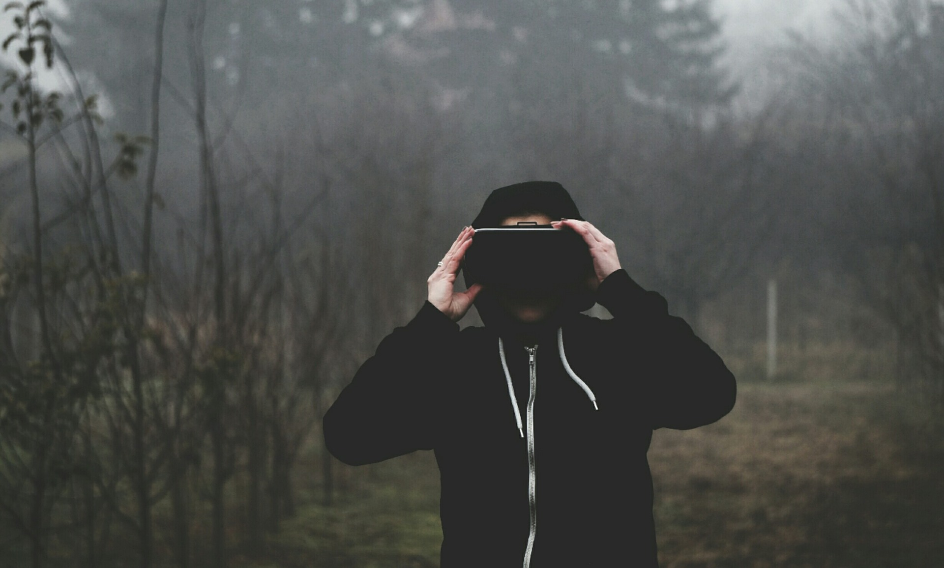 Man in virtual reality glass in the forest