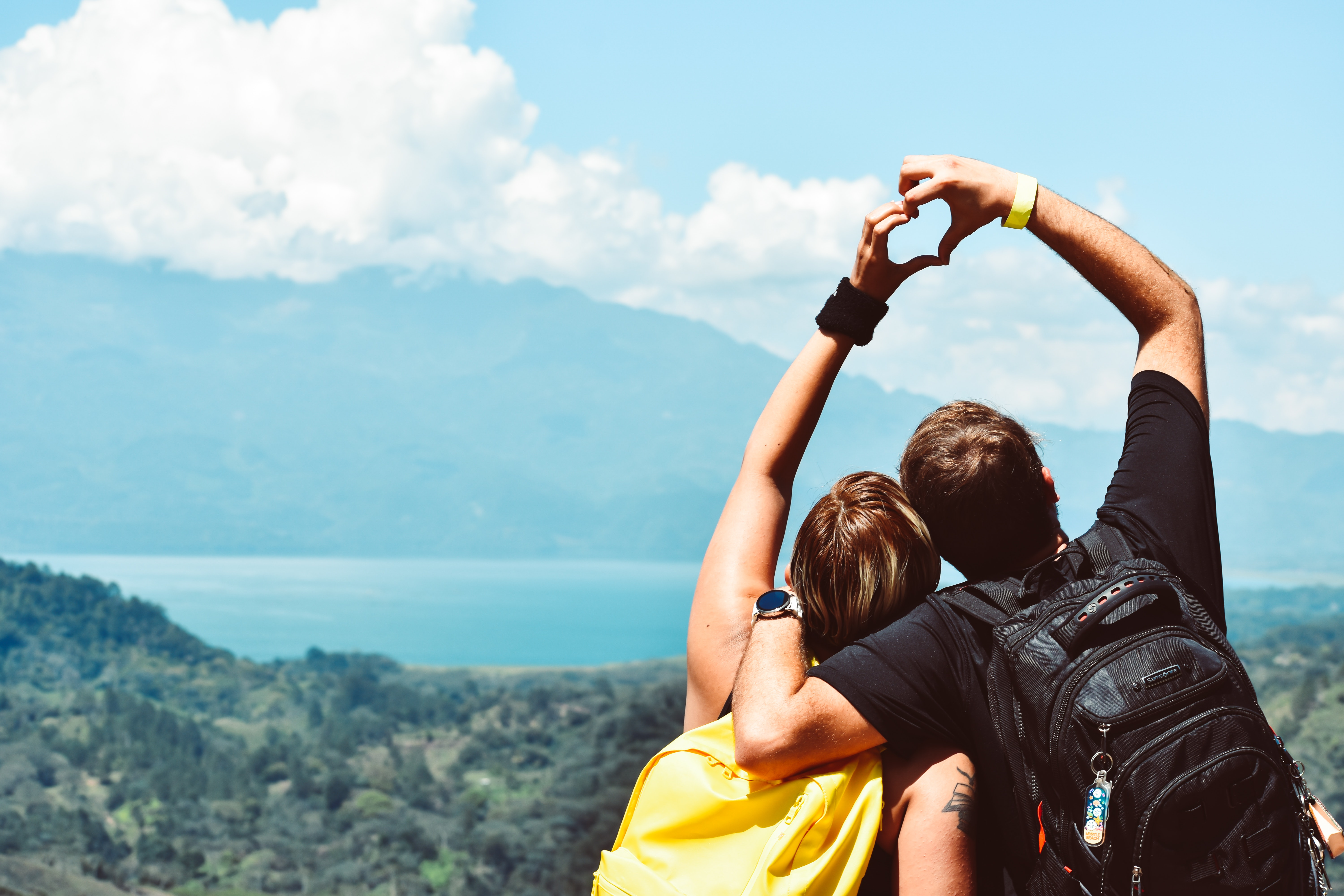 Lovers on a mountain with the view of a lake