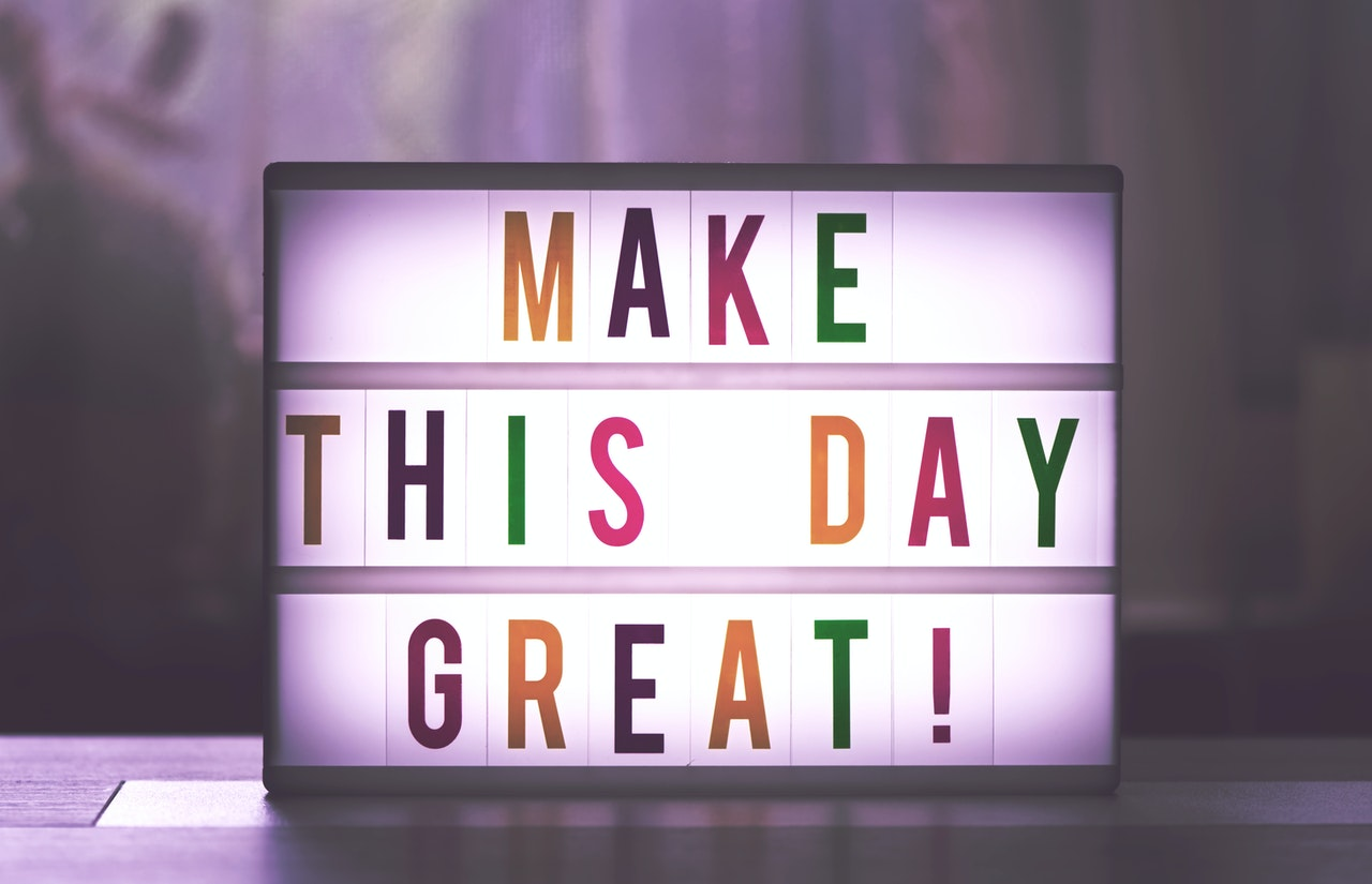 """""""Make this day great"""" written on a glowing box"""