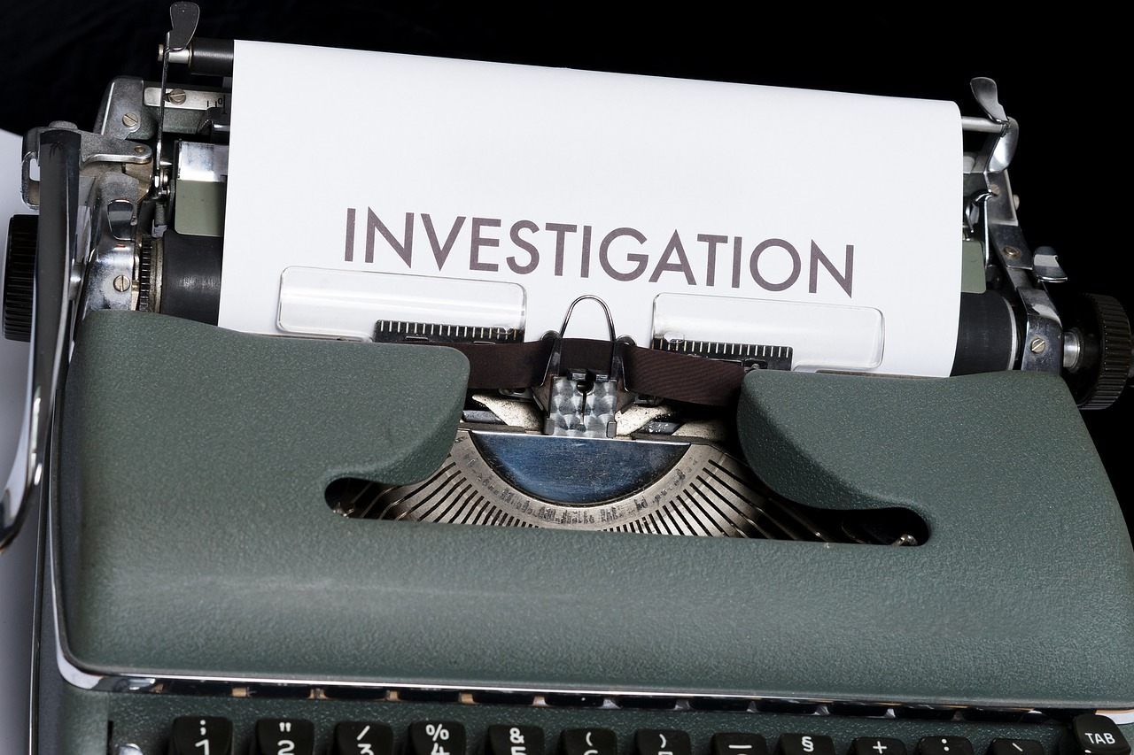 """Typewriter with a paper written """"INVESTIGATION"""" on it"""