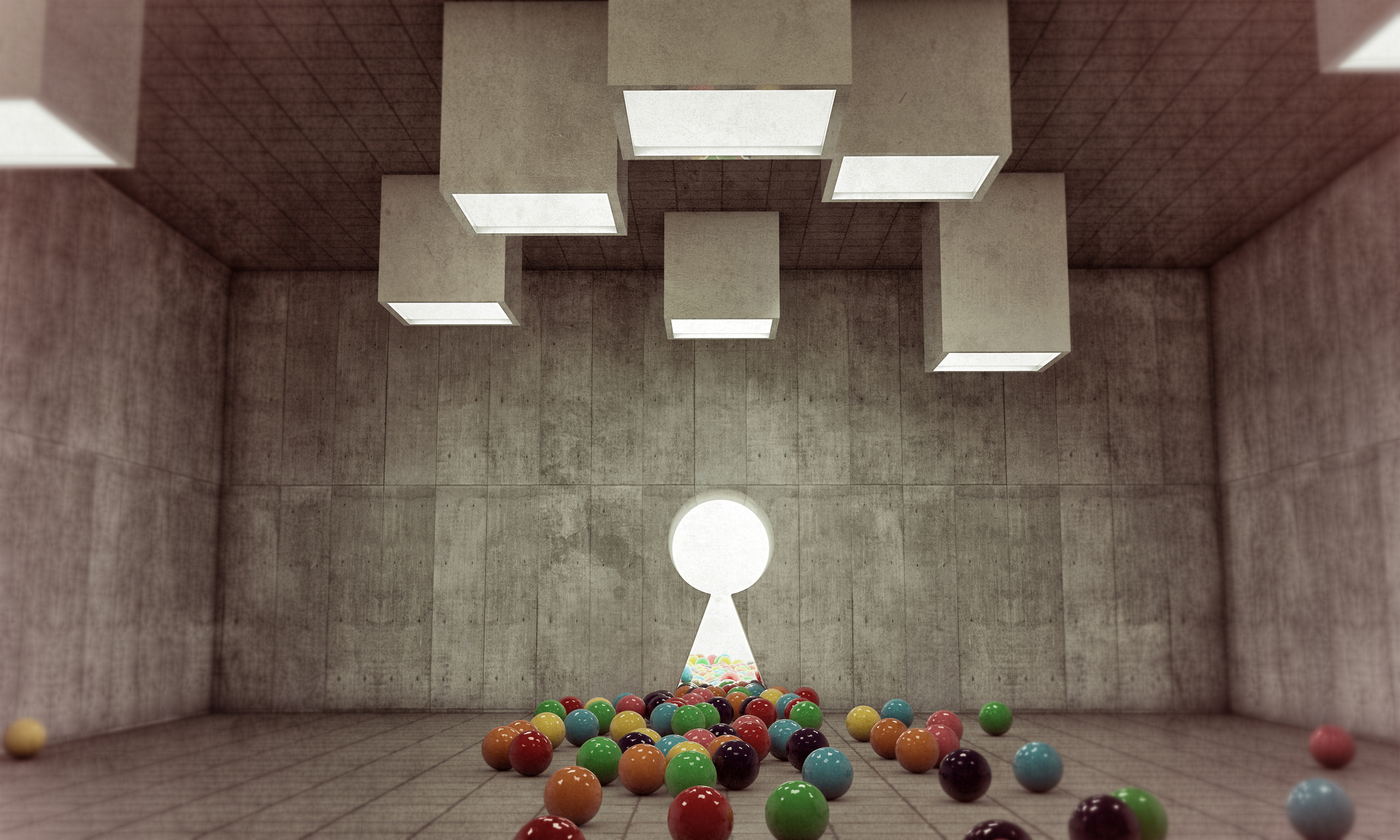 Assorted balls of different colors on the floor of a spacious white room with large keyhole window leading to the outdoors