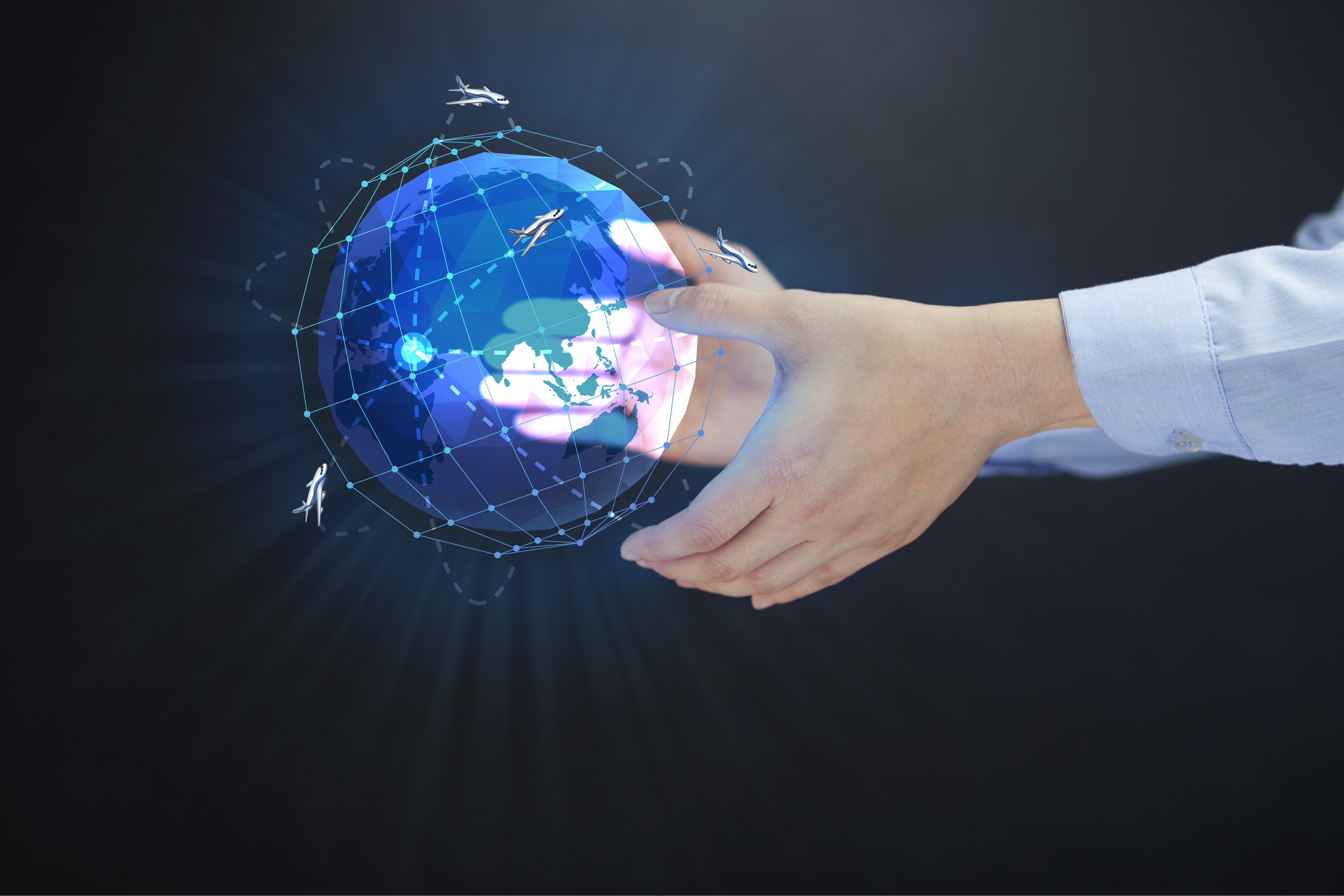 Hands hold a holographic globe in midair.
