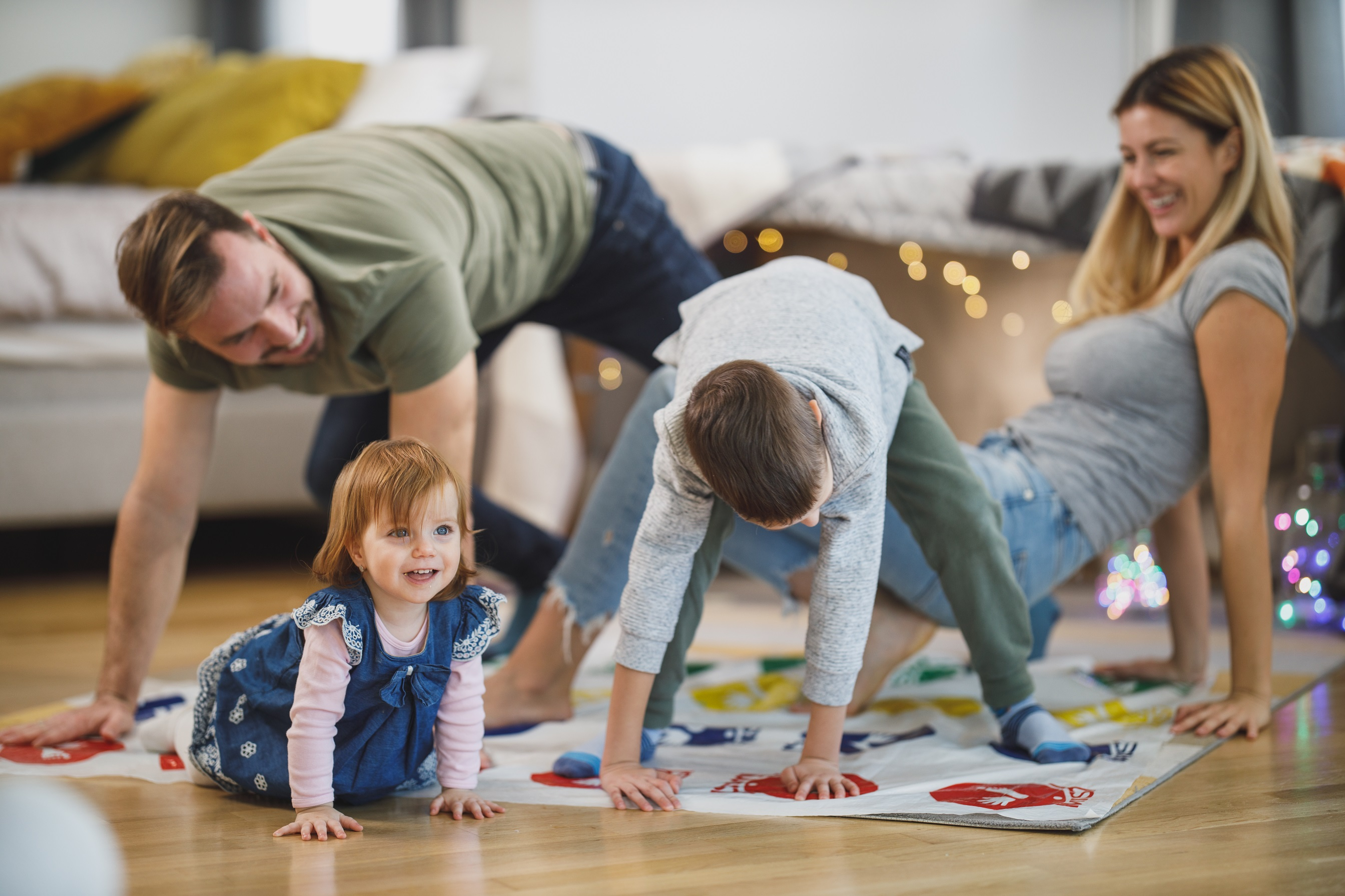 Mum and dad playing with children on the floor