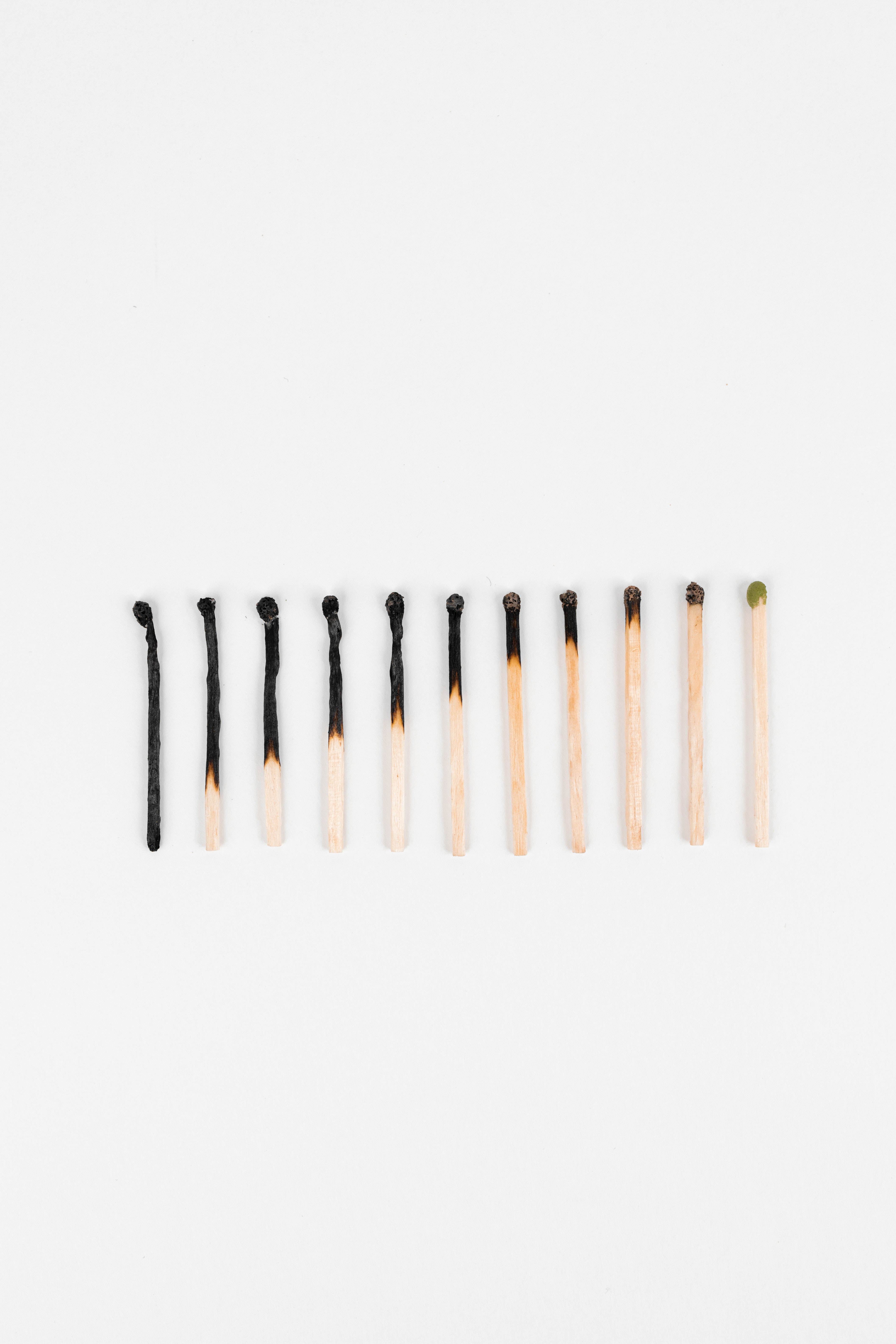 Burnt matches on a white table