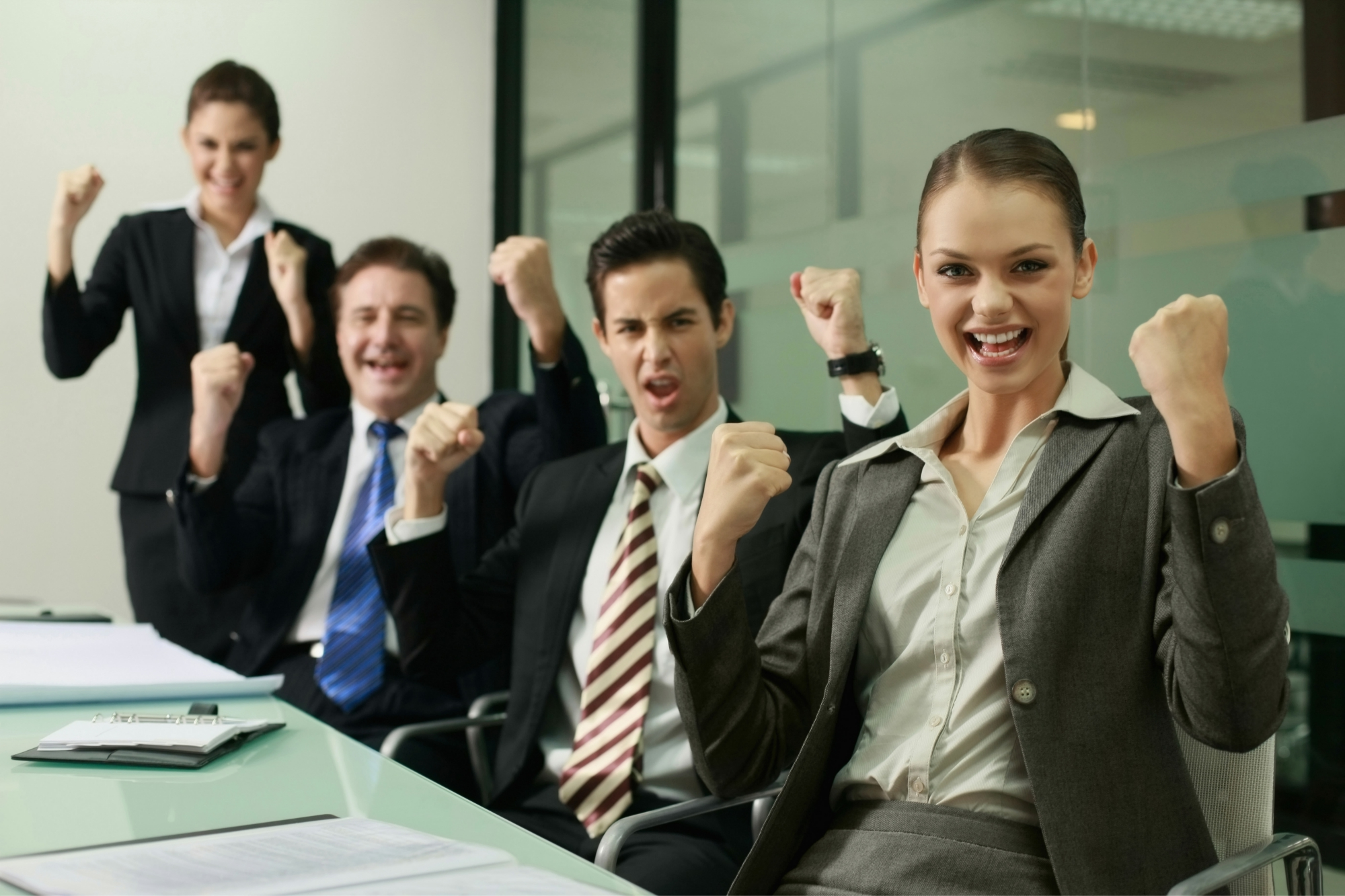 Business personnel posing for victory at the office