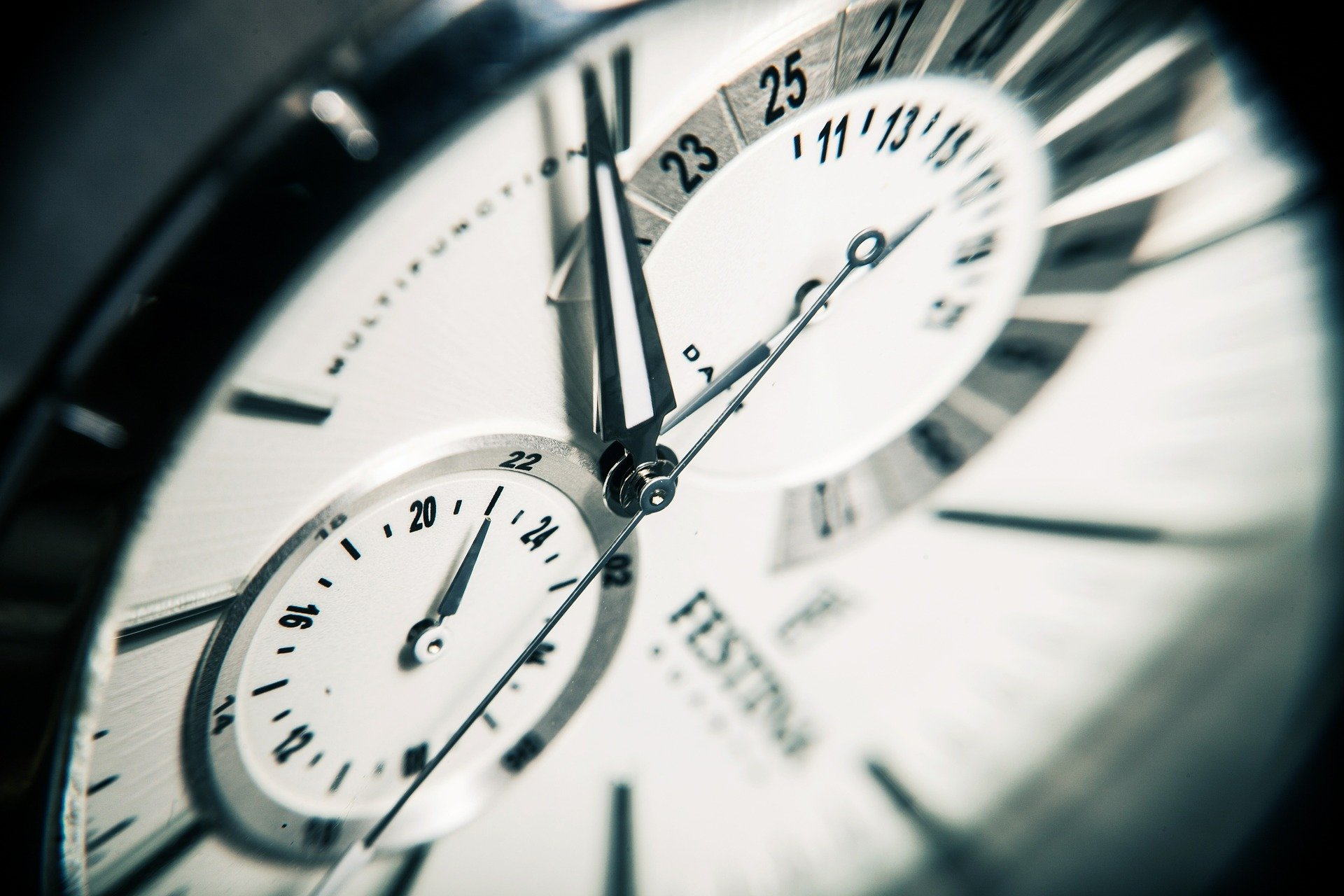 clock face of a watch showing minutes, seconds passing